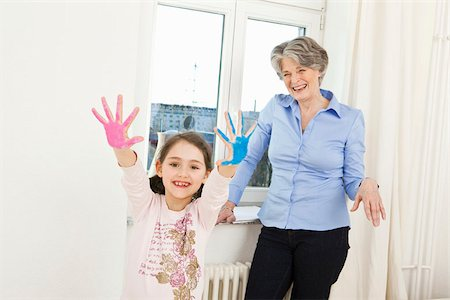 finger painting - A grandmother and her granddaughter finger painting Stock Photo - Premium Royalty-Free, Code: 653-02835247