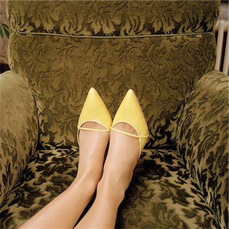spike - Detail of a woman wearing high heel shoes and with her feet up on an armchair Stock Photo - Premium Royalty-Free, Code: 653-02835350