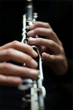 Human hands playing a clarinet Stock Photo - Premium Royalty-Free, Code: 653-02835430