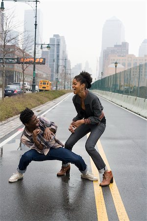 A young couple play fighting on a street, Manhattan, New York City Stock Photo - Premium Royalty-Free, Code: 653-02835873