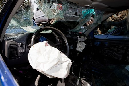 Inside of a car in a junkyard Stock Photo - Premium Royalty-Free, Code: 653-03079466