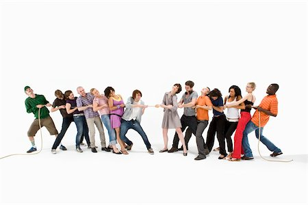 A group of men and women playing tug of war Stock Photo - Premium Royalty-Free, Code: 653-03079497