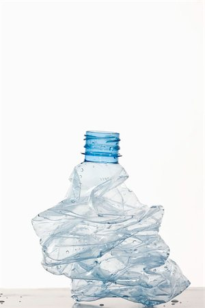 A crumpled plastic water bottle Stock Photo - Premium Royalty-Free, Code: 653-03079588