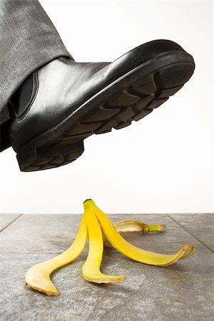 dangerous accident - A foot above a banana peel Stock Photo - Premium Royalty-Free, Code: 653-03079684