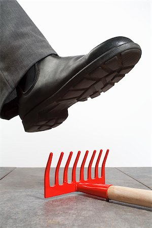 dangerous accident - A foot above a rake Stock Photo - Premium Royalty-Free, Code: 653-03079704