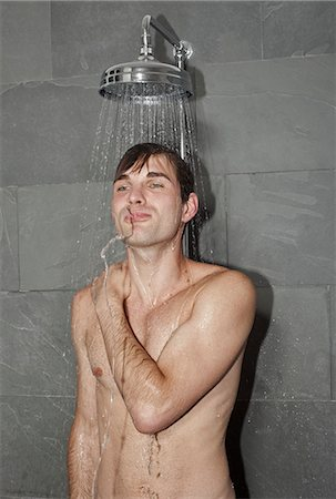A man taking a shower Stock Photo - Premium Royalty-Free, Code: 653-03334037