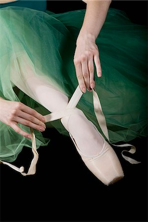 The hands of ballet dancer tying a pointe shoe Stock Photo - Premium Royalty-Free, Code: 653-03334251