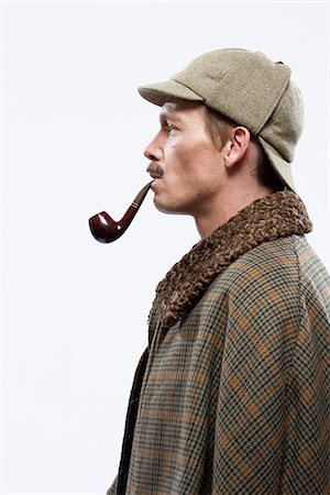 A man dressed up as Sherlock Holmes Stock Photo - Premium Royalty-Free, Code: 653-03334454