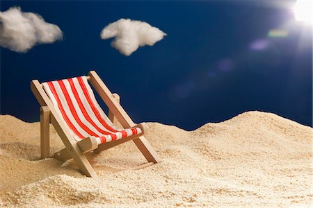 sandi model - A miniature beach chair in sand Stock Photo - Premium Royalty-Free, Code: 653-03334582