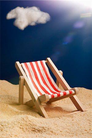 sandi model - A miniature beach chair in sand Stock Photo - Premium Royalty-Free, Code: 653-03334619