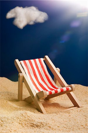 sandi model - A miniature beach chair in sand Stock Photo - Premium Royalty-Free, Code: 653-03334619