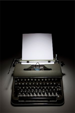 An old-fashioned typewriter with paper Stock Photo - Premium Royalty-Free, Code: 653-03334620