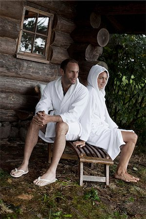 A couple relaxing outside the sauna at a health spa Stock Photo - Premium Royalty-Free, Code: 653-03333836