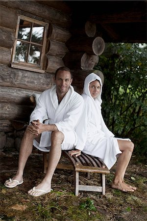 A couple relaxing outside the sauna at a health spa Stock Photo - Premium Royalty-Free, Code: 653-03333839