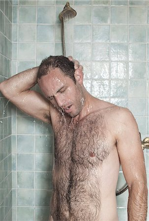 A man taking a shower in a spa Stock Photo - Premium Royalty-Free, Code: 653-03333855