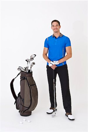 A man standing with golfing equipment Stock Photo - Premium Royalty-Free, Code: 653-03333973