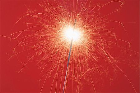 sparkling - A lit sparkler Stock Photo - Premium Royalty-Free, Code: 653-03459261