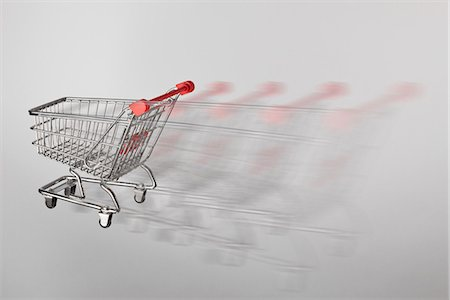 empty shopping cart - A miniature shopping cart on the move Stock Photo - Premium Royalty-Free, Code: 653-03459271