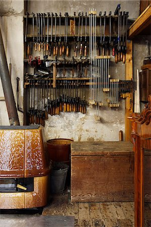 New and old vices hanging in a woodworkers workshop Stock Photo - Premium Royalty-Free, Code: 653-03459379