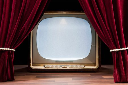 An Old Fashioned Television Behind Red Theatre Curtains Stock Photo - Premium Royalty-Free, Code: 653-03459721