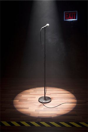 A Microphone Illuminated On A Stage Stock Photo - Premium Royalty-Free, Code: 653-03459736