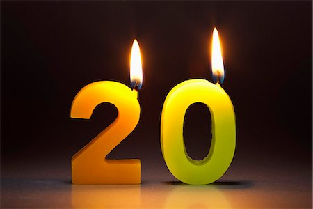 Two Candles In The Shape Of The Number 20 Stock Photo - Premium Royalty-Free, Code: 653-03459748