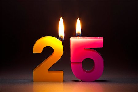 Two Candles In The Shape Of The Number 25 Stock Photo - Premium Royalty-Free, Code: 653-03459742