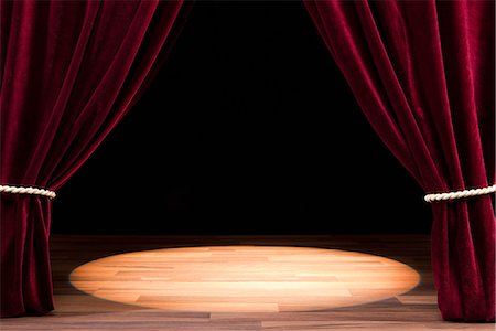 A Spot Lit Empty Theatre Stage Stock Photo - Premium Royalty-Free, Code: 653-03459760