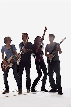 A rock band performing, studio shot, white background, back lit Stock Photo - Premium Royalty-Free, Code: 653-03459944
