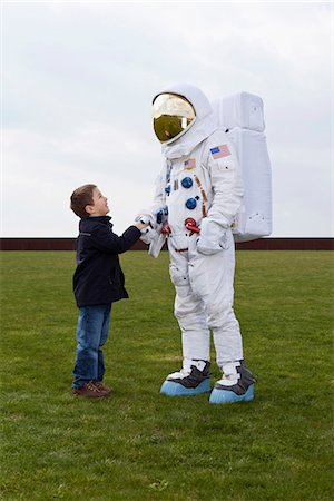 A boy shaking hands with an astronaut Stock Photo - Premium Royalty-Free, Code: 653-03575362