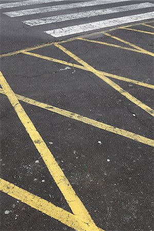 Detail of painted lines on asphalt Stock Photo - Premium Royalty-Free, Code: 653-03575601
