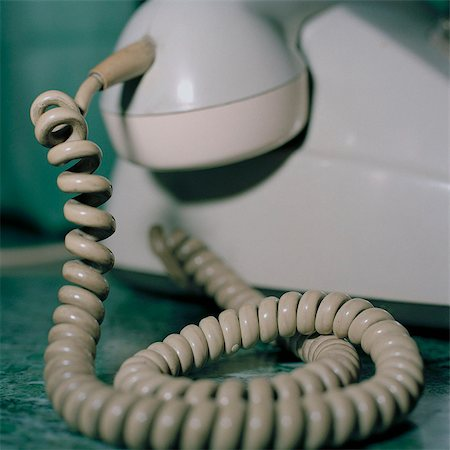phone cord - Detail of an old fashioned telephone Stock Photo - Premium Royalty-Free, Code: 653-03575784