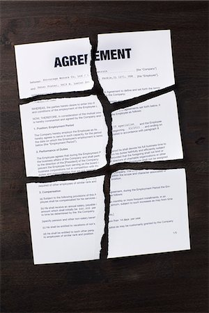An employment agreement torn into pieces Stock Photo - Premium Royalty-Free, Code: 653-03575854
