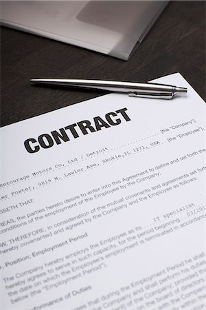An employment contract and a pen Stock Photo - Premium Royalty-Free, Code: 653-03575853