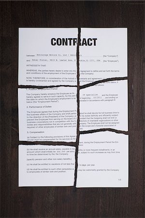 An employment contract torn into pieces Stock Photo - Premium Royalty-Free, Code: 653-03575860