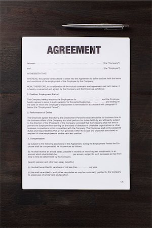 An employment agreement and a pen Stock Photo - Premium Royalty-Free, Code: 653-03575862