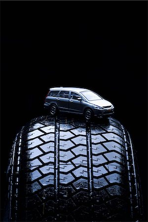 Detail of a toy car on a tire Stock Photo - Premium Royalty-Free, Code: 653-03575937