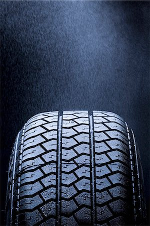 Detail of mist falling on a car tire Stock Photo - Premium Royalty-Free, Code: 653-03575933
