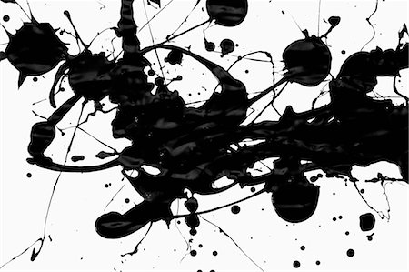 paint dripping abstract pattern - Splatter black paint on a white surface Stock Photo - Premium Royalty-Free, Code: 653-03576212