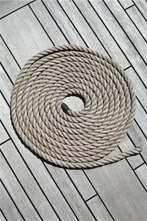 spiral - Coiled rope on a wooden deck Stock Photo - Premium Royalty-Free, Code: 653-03576213