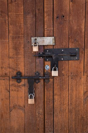 Detail of bolted locks on a wooden door Stock Photo - Premium Royalty-Free, Code: 653-03705957