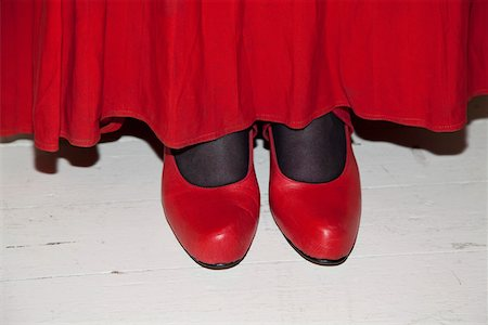 stocking feet - Detail of a woman wearing a red skirt and red shoes Stock Photo - Premium Royalty-Free, Code: 653-03705959