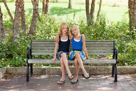 preteen thong - Two Girls legs crossed on a bench Stock Photo - Premium Royalty-Free, Code: 653-03706040