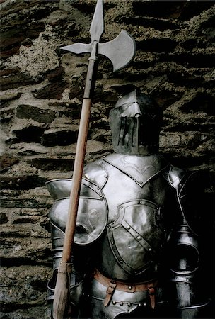 Suit of armor with an axe Stock Photo - Premium Royalty-Free, Code: 653-03706057