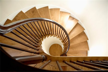 Spiral stairs from above Stock Photo - Premium Royalty-Free, Code: 653-03706188