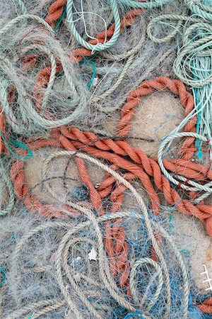 Detail of ropes and fishing nets on the ground Stock Photo - Premium Royalty-Free, Code: 653-03706321
