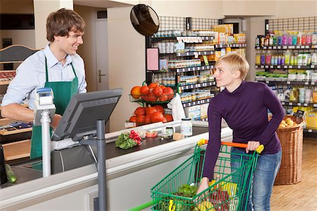 A customer checking out in a supermarket Stock Photo - Premium Royalty-Free, Code: 653-03706436