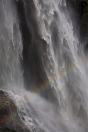 Detail of a rainbow and a waterfall Stock Photo - Premium Royalty-Free, Code: 653-03706579