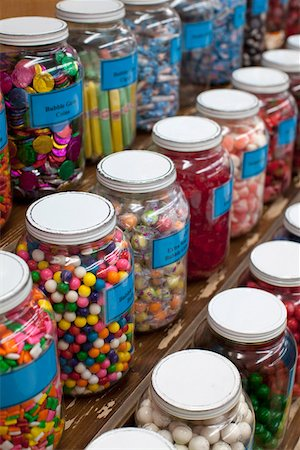 Rows of candy jars in a candy store Stock Photo - Premium Royalty-Free, Code: 653-03706625