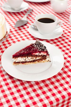 A slice of cake and cup of coffee Stock Photo - Premium Royalty-Free, Code: 653-03706630